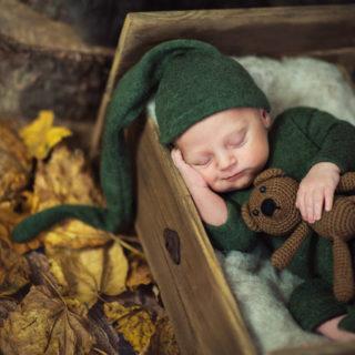 słodki uśmiech dziecka, fotografia noworodkowa, konin