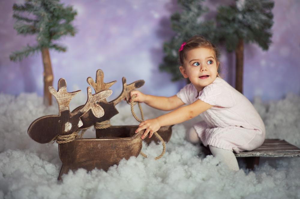 zaprzęg reniferów w sesji dziecięcej
